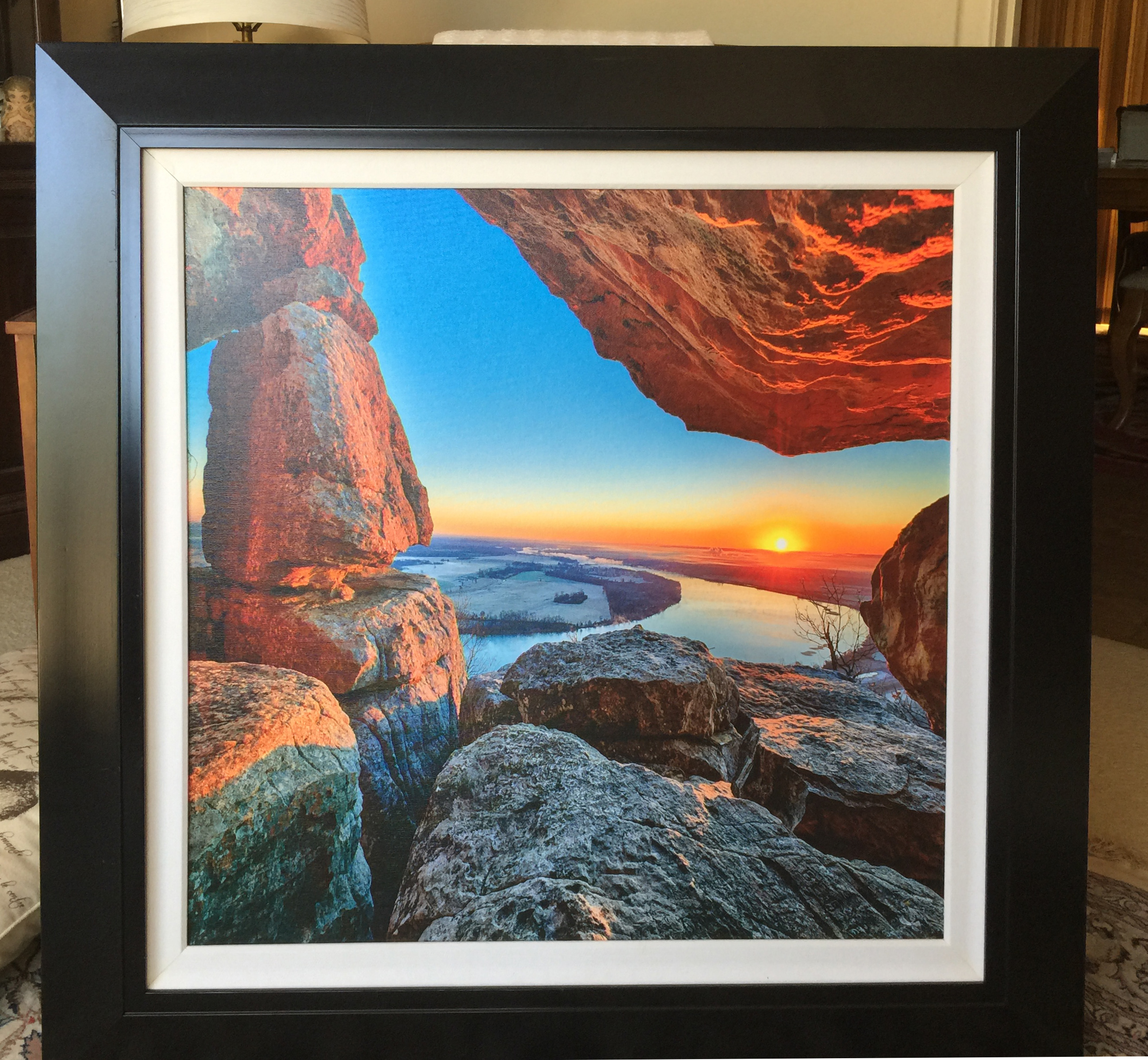 an example of a finished and framed canvas print on gator board